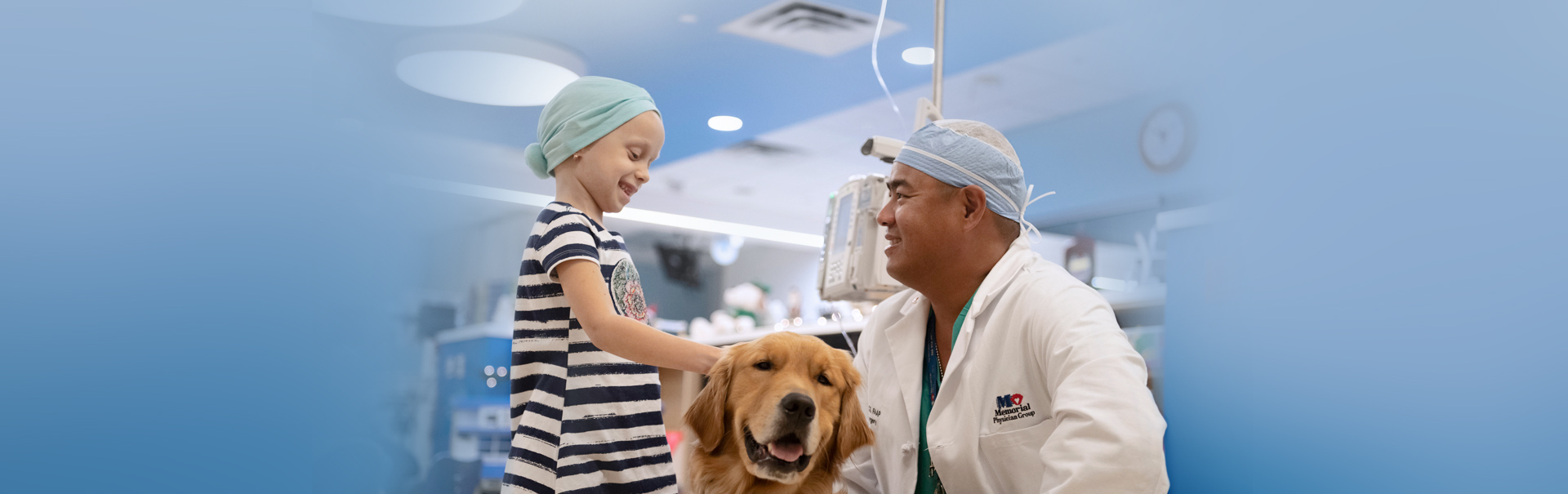 Oliver B Lao, MD with patient and therapy dog